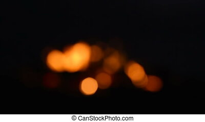 Bokeh blurred dots of fire in campefire