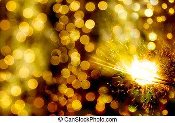bokeh christmas lights and sparkler