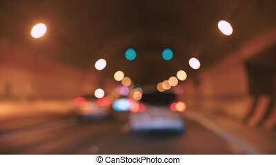 bokeh effect of car traffic in the tunnel