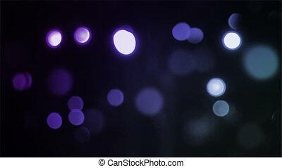 Bokeh Flow Purple - Flowing bokeh particles drift across the...