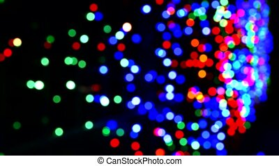 Bokeh from the festive illumination at night. Abstract bokeh background of Christmas night, outdoor. Round colorful bokeh Shine in the dark, 4K Video