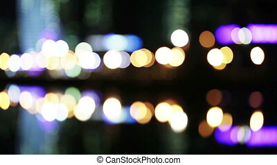 Bokeh night traffic reflection water
