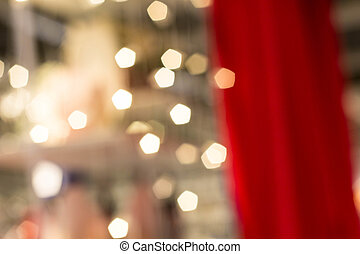 Bokeh of Christmas light garland on the red curtain