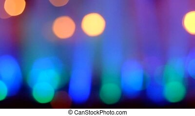 Bokeh of fountain lights with color effect reflected on water
