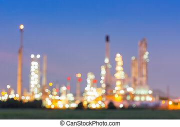 Bokeh of oil refinery plant at twilight, Blur background.