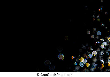 bokeh of water drops levitating in the air reflection with light