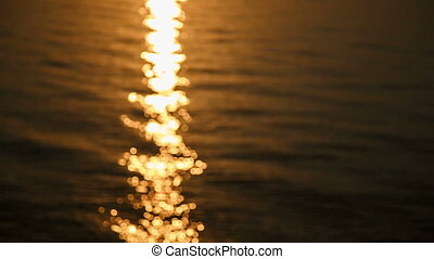 Bokeh on sunlight and defocused sea