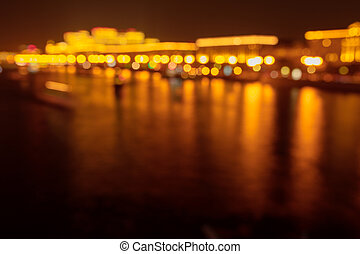 Bokeh river in the city at night as a background