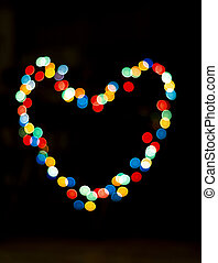 Bokeh with the shape of a heart with multi colors