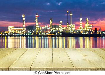Bokeh wood table - Bokeh of oil refinery factory at twilight...