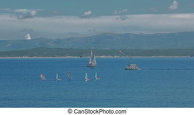 Bol blue sea - Small and large sailboats sail in the...