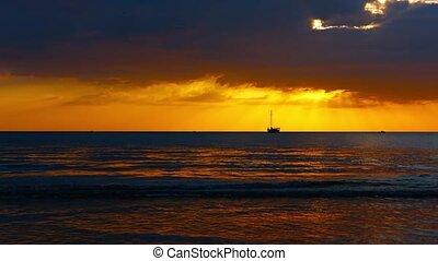 Bold Orange Sunset over a Tropical Seascape