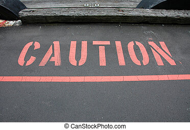Bold Red Caution warning of danger ahead