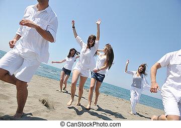 boldog, emberek, csoport, szórakozik, és, futás, képben látható, tengerpart