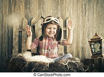boldog, kölyök, játék, alatt, pilóta, sisak