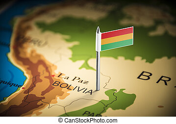 Bolivia marked with a flag on the map