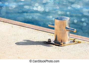 Bollard in sunlight at a jetty