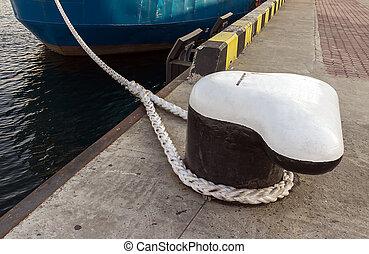 Bollard - knecht on the bollard of sea commercial port