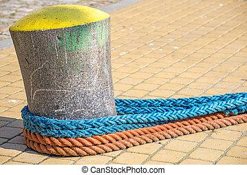 Bollard with mooring lines