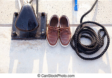 Bollard with nautic shoes and rope coil
