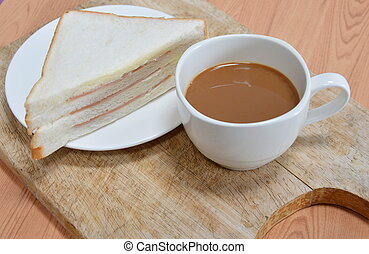 bologna sandwich and coffee