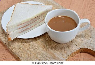 bologna sandwich and coffee