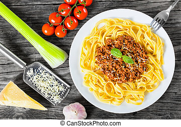 Bolognese ragout with italian pasta on a white plate, decorated