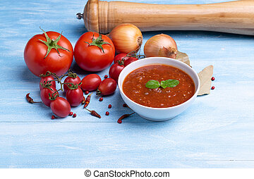 Bolognese with tomato sauce in a white plate on rustic wooden blue table background, soft light