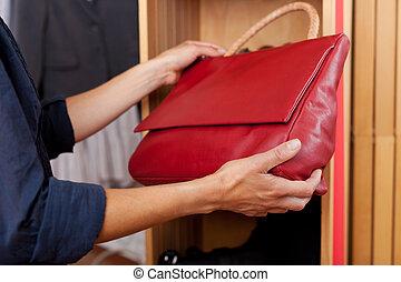 bolsa, vermelho, loja, segurando