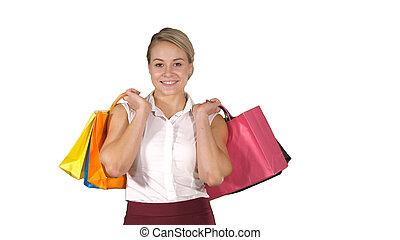bolsas, ambulante, compras de mujer, algunos, joven, fondo., mientras, blanco, asimiento