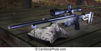 Bolt action rifle on a shooting bench