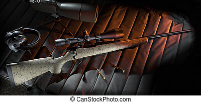 Bolt action rifle on a shooting mat