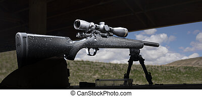 Bolt action rimfire rifle on a shooting bench