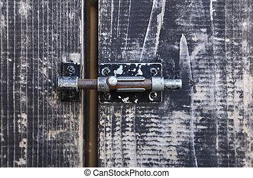 Bolt on old wooden door