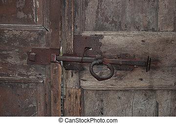 Bolt on the wooden door