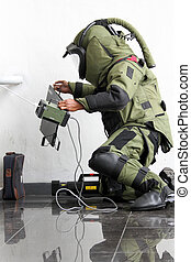 Bomb squad - Member of bomb squad assigned to defuse...