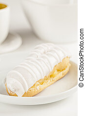 Bomba de chocolate. A Brazilian traditional eclair on a white background.