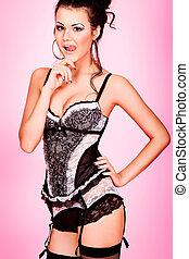 bombshell - Beautiful young woman in lingerie. Studio shot.
