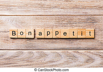 Bon Appetit word written on wood block. Bon Appetit text on wooden table for your desing, concept