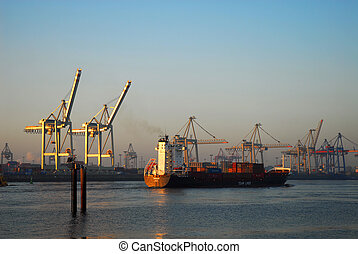 Bon voyage - Cargo ship is leaving Hamburg harbour.