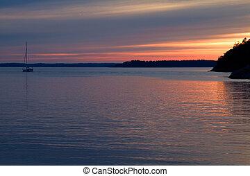 Bon Voyage! - Sailboat leaving at sunset.