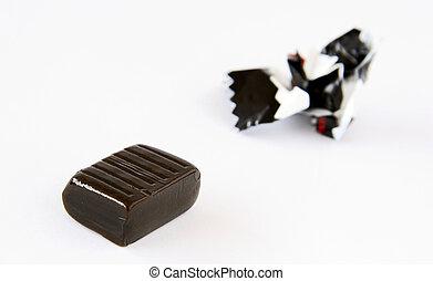 Bonbon - An isolated black bonbon on a white bacground