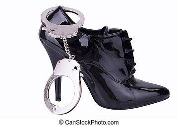 Bondage concept - Handcuffs and high heel, isolated on white...