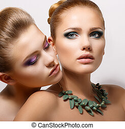 Bonding. Allure. Faces of Two Sensual Pretty Women Closeup. ...