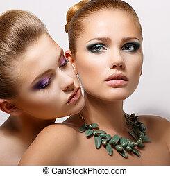 Bonding. Allure. Faces of Two Sensual Pretty Women Closeup....