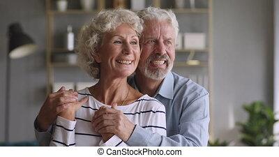 Bonding attractive older senior family couple dreaming of ...