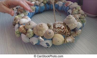 Bonding seashells on decorative