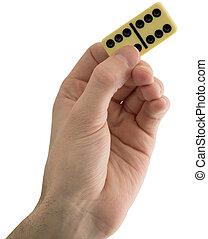 Bone dominoes on hand - Bone dominoes on male hand on the ...