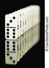 Bones of dominoes on a black background
