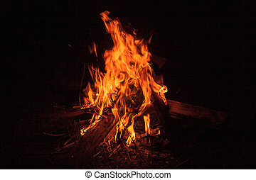 Camping Bonfire with sparks at night time